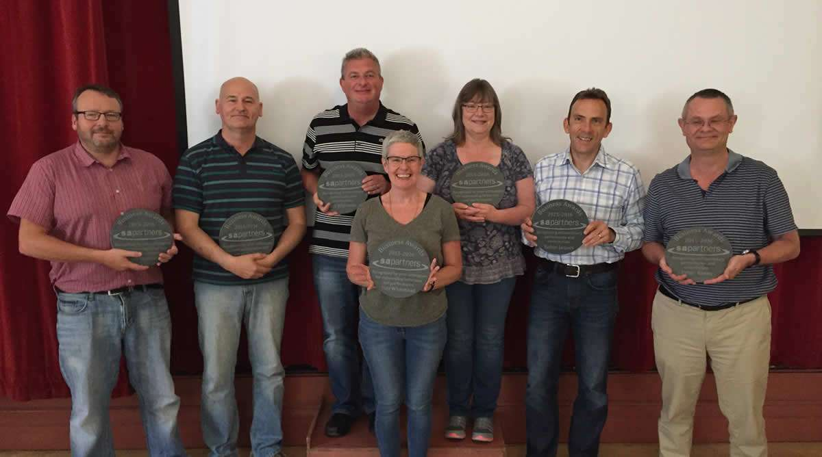 group photo of S A Partners employees with their awards