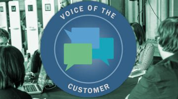 image of our voice f the customer logo on top of a table of students