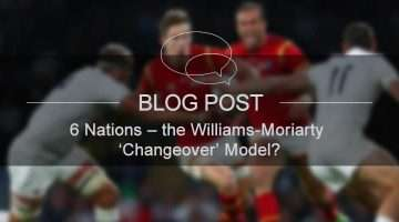 image of welsh rugby player being tackled by english rugby player
