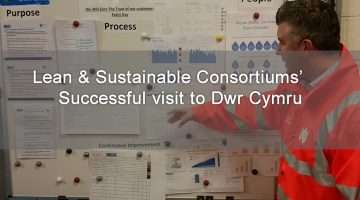 image of Dwr Cymru employee looking at visual management boards