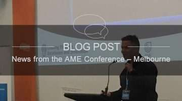 iAME conference blog news banner showing man giving speech