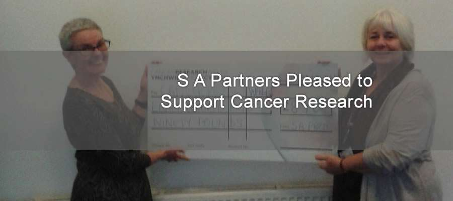 toni donating cheques to Coleen Watkins of Cancer research