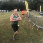 Mick running towards the finish line