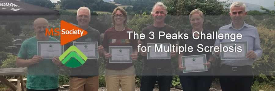 the 3 peaks team stand for a photo with certificate