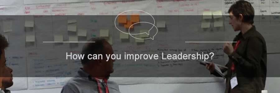 image of a team developing leadership skills at a leadership workshop with postit notes on the board