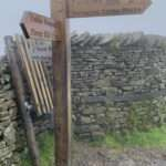 wooden sign post pointing to 3 Peaks Challenge