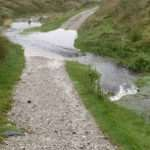 image of footpath with stream running across it