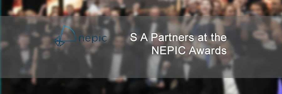 banner showing blurred award winners at the NEPIC awards ceremony