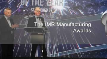 banner image for IMR awards presentation with John Quirke on stage