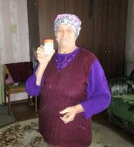 chernobyl pensioner with vitamins