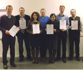 group of poeple awarded certificates