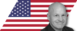 image of colin scott with us flag in the background