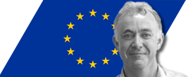 image of john quirke with eu flag in the background