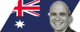 image of richard young with au flag in thebackground