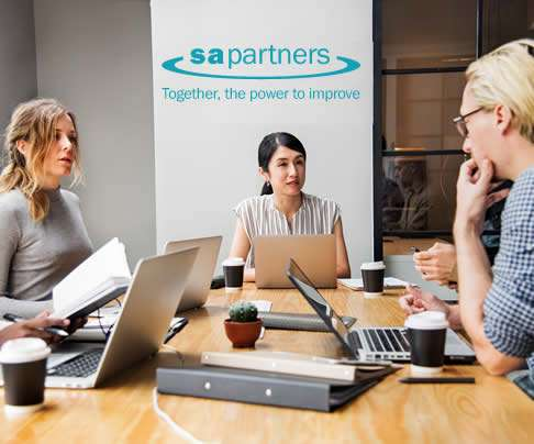 group of people in an S A Partners office